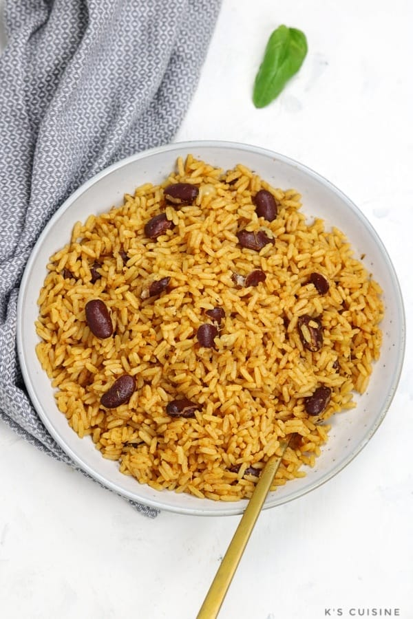 rice and beans served in white plate.