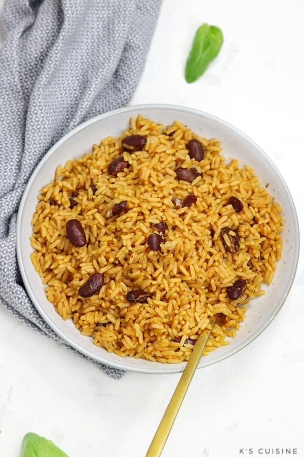 Rice and beans served in a light blue plate.
