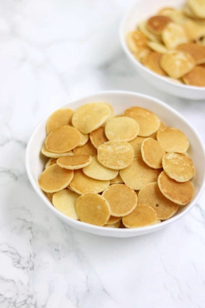 mini pancakes served in two bowls.