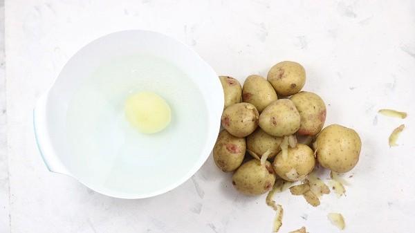Peeling the potatoes.