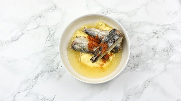 sardines, butter and cayenne pepper in a bowl.