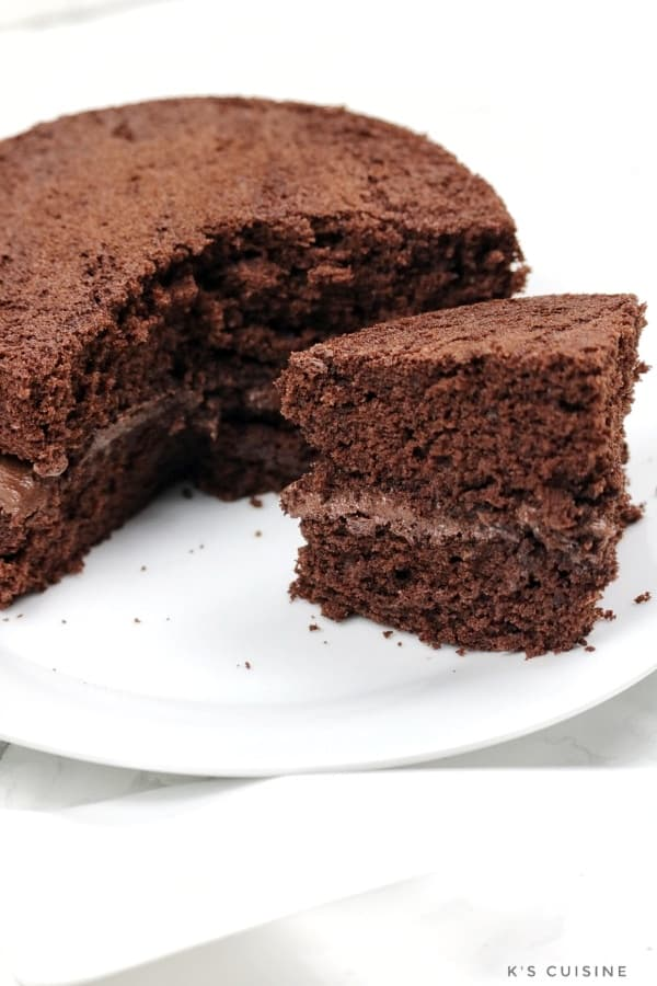 chocolate cake with aportion cut out.
